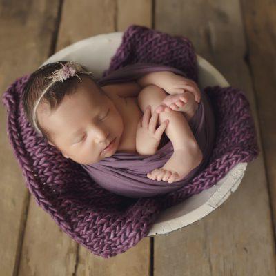 wrapped in purple newborn studio session