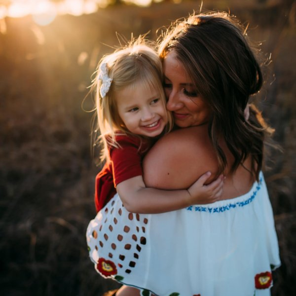 mommy daughter hug sunset